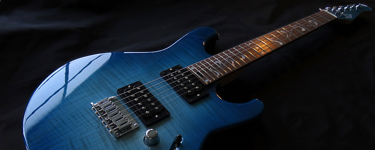 "The Liberty model | The ""Rock"" version with hard tail bridge-tailpiece (Cyan burst finish)"